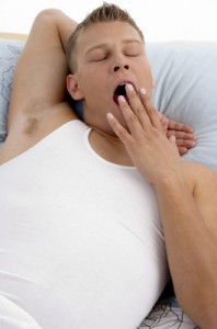 Sleep Apnea Doesn't Discriminate - Young Man Yawning